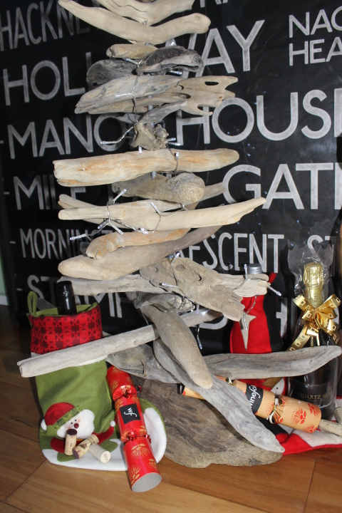Driftwood Christmas tree with NZ wine and crackers